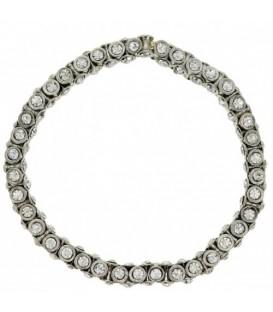 Zilverkleurige flexibele armband met heldere strass steentjes