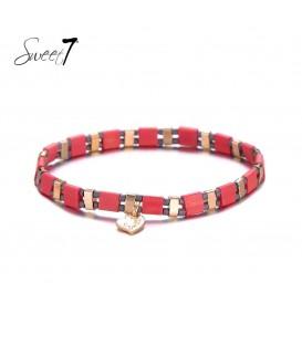 rode elastische armband met goudkleurige details